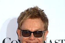 Elton John Sparks Controversy With Boycotted D&G Bag