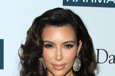 Kim Kardashian Stuns in Low-Cut Dress for Charity Event!
