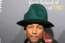 Pharrell Empties Pockets, Flirts With Reporter On Red Carpet
