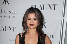 """Selena Gomez Poses Topless, Talks """"First Love"""" With Justin Bieber"""