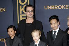 Brad Pitt And Kids Attend Unbroken Premiere