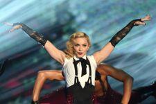 """Giorgio Armani Blames """"Difficult"""" Madonna For Cape Mishap"""