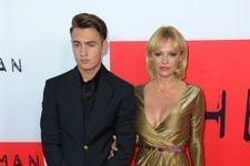 Pamela Anderson Brings Gorgeous Son To 'The Gunman' Premiere