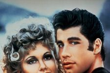 John Travolta And Olivia Newton-John Dressed Up As Danny And Sandy For A 'Grease' Sing-Along Event